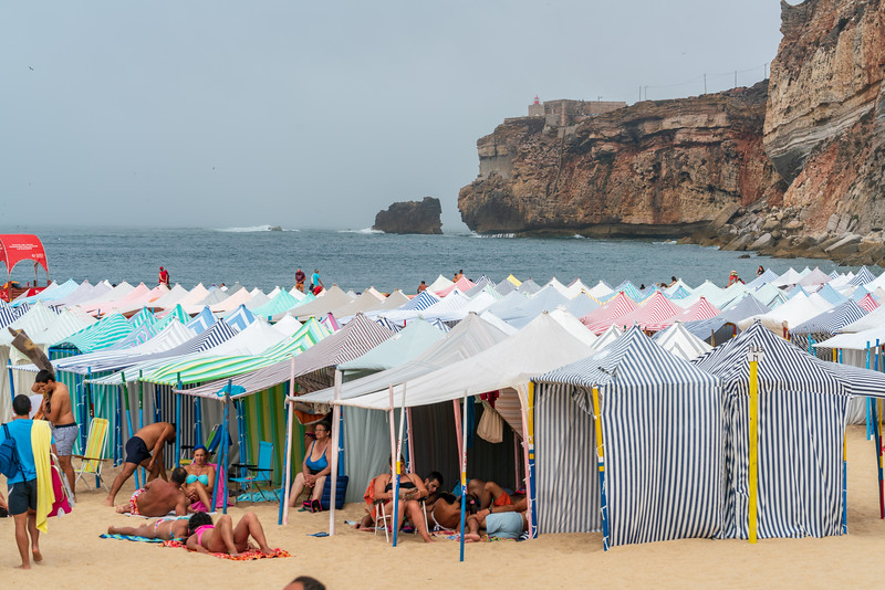 Beach tents and the cliffs in Nazare.