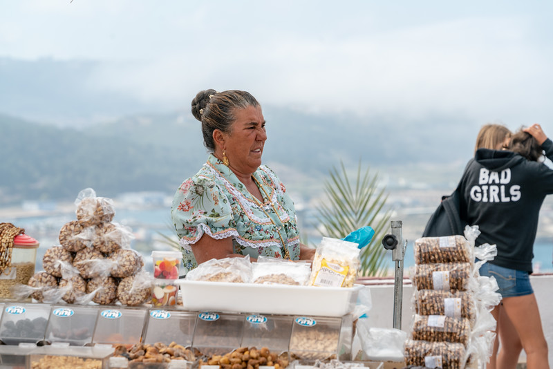 A woman selling treats in Sitio.
