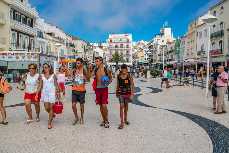 People strolling through the main square in Nazare.