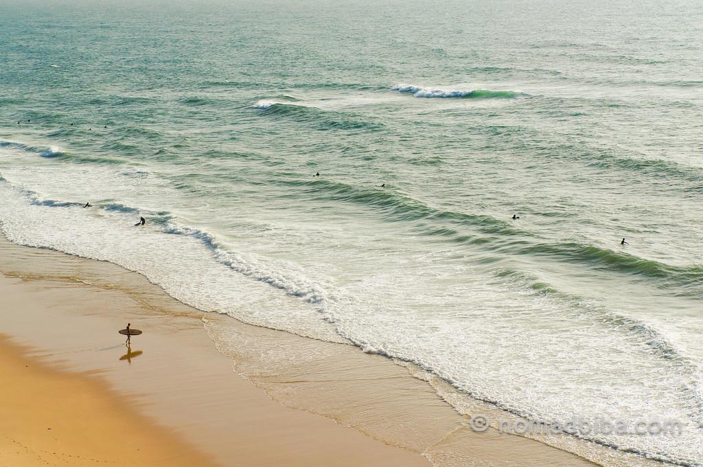 Surfers in Praia Pequena, Sintra (Portugal)