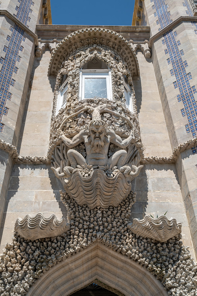 """The Arch of the Triton is one of the most enigmatic architectonic features of the Palace of Pena. Entitled the """"Allegoric Gate to the creation of the World"""" right in the 19th century, its most prominent facet is its Triton, a mythological monster, half-man and half-fish. Similarly, all of the arch is divided between the aquatic world below and the terrestrial world above."""
