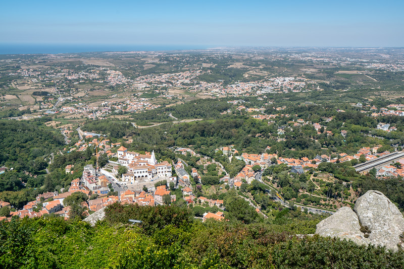 Looking down on the town of Sintra from The Castle of the Moors. You can see the train station to the right and the Atlantic Ocean in the distance.