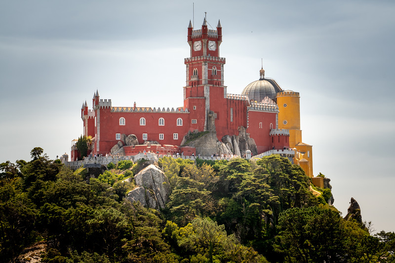 Looking up at Pena Palace from The Castle of the Moors.