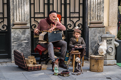 hurdy-gurdy man with cockatoo puppets and son