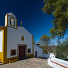small white and yellow church outside Castelo de Vide