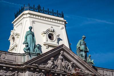 nine statues on top of bank Porto