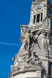 statuary on tower of bank Porto