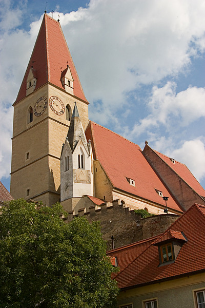 <center>Church in Joching, Austria   <br><br>Joching, Austria   <br><br>Another town, andother church with a clock tower.    </center>