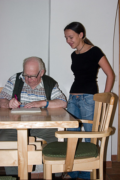 <center>Generations   <br><br>Gross Pertholz, Austria   <br><br>The owner of the paper mill and his granddaughter (who wants no part of the paper business, I might add) autograph our packet of hand-made paper.    </center>
