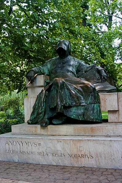 <center>Statue of Anonymus   <br><br>Budapest, Hungary   <br><br>The Statue of Anonymus is directly opposite the entrance to Vajdahunyad Castle. The statue was created by sculptor Mikl�s Ligeti. The figure in the statue was the chronicler of King B�la and recorded the early history of the Magyars.    </center>