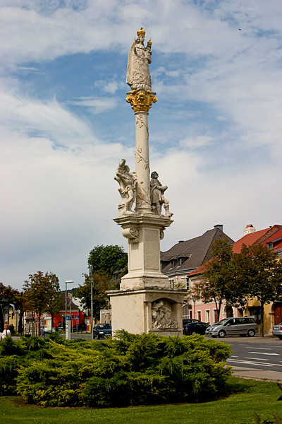 <center>Gold Crown   <br><br>Eisenstadt, Austria   <br><br>Like most towns, Eisenstadt has a beautiful statue adorned in gold in the center of town.    </center>