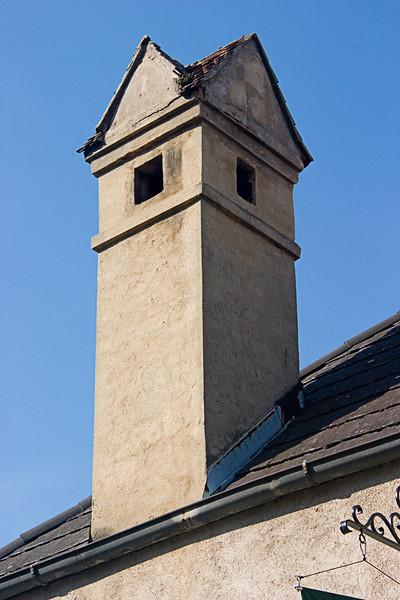 <center>Odd Shaped Chimney   <br><br>Durnstein, Austria   <br><br>I don't think I've ever seen a roof on a chimney before.    </center>