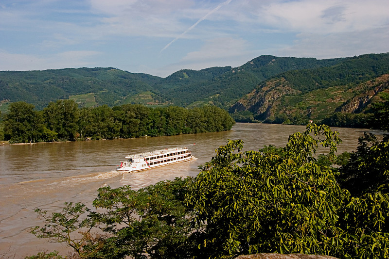 <center>Danube   <br><br>Durnstein, Austria   <br><br>Small river cruise ships constantly sailed the Danube. The current was very swift, however, and the ships really struggled to make it to that bend.    </center>