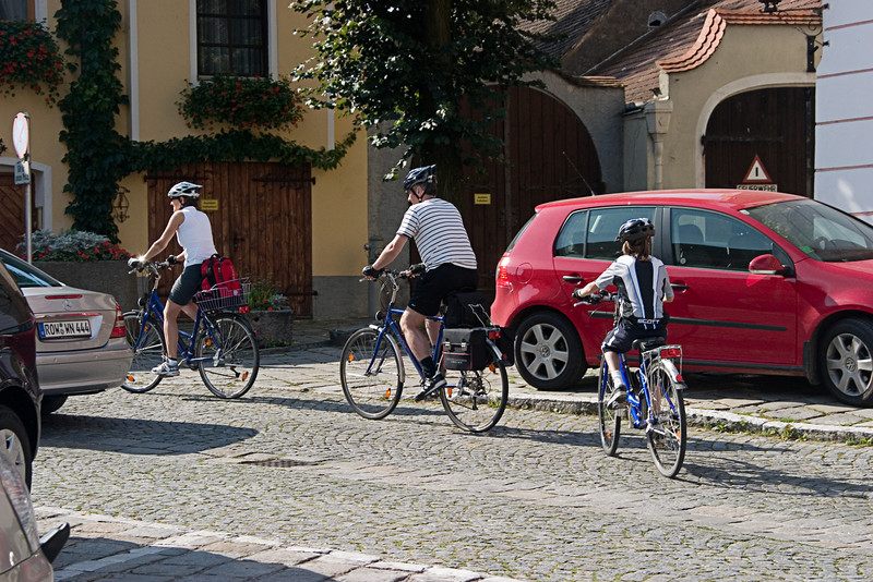 <center>Family Cycling   <br><br>Durnstein, Austria   <br><br>Another family was seen cycling through Durnstein.    </center>