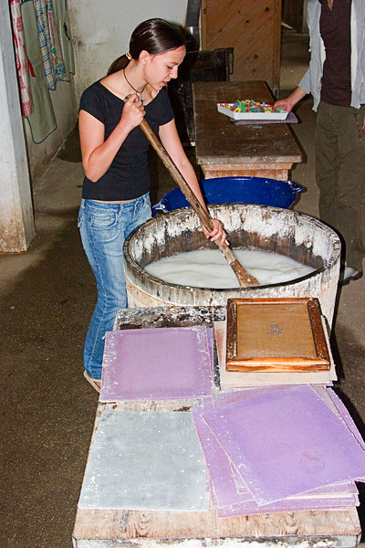 <center>Mixing the Pulp   <br><br>Gross Pertholz, Austria   <br><br>Katharina, the granddaughter of the mill's owner, stirs the pulp to ensure an even distribution.    </center>