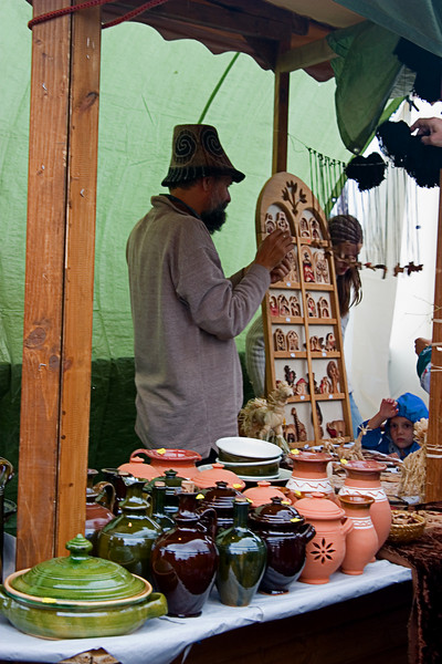 <center>Pottery Stall   <br><br>Budapest, Hungary   <br><br>This local merchant sells pottery at the festival.    </center>