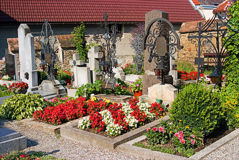 <center>Church Cemetery   <br><br>Durnstein, Austria   <br><br>The graves in this church cemetery were very well tended and covered with colorful flowers.    </center>