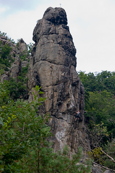 <center>Hoodoo   <br><br>Durnstein, Austria   <br><br>A climber scrambles up this hoodoo. Notice the cross at the top.    </center>