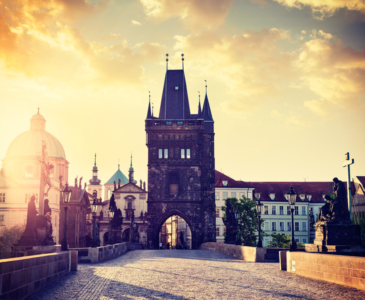 Charles bridge tower in Prague on sunrise