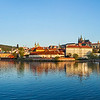 Panorama of Prague: Gradchany (Prague Castle), St. Vitus Cathedral and Charles Bridge over Vltava river on sunset