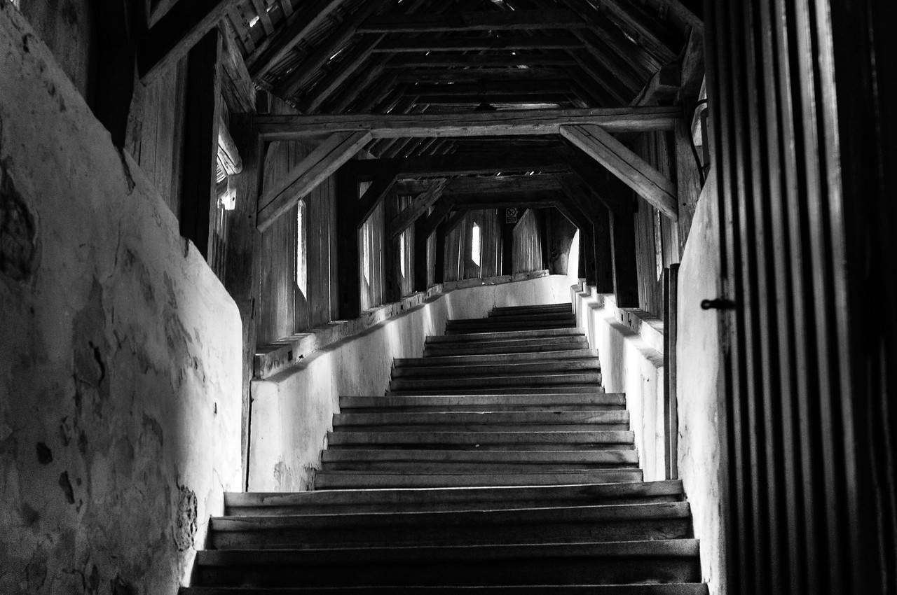 Wooden stairs at Calnic Fortified Church in B&W - Transylvannia, Romania