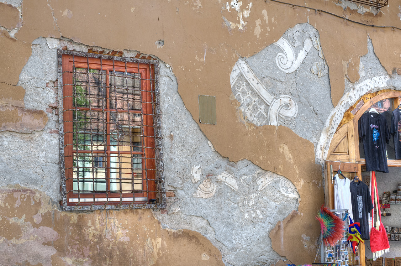 Window and a dilapidated wall on a building in Romania
