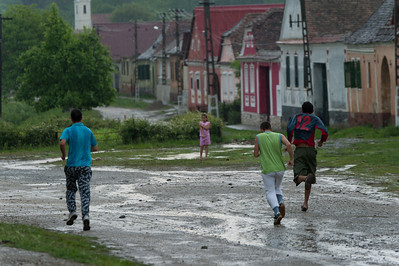 Kids playing on the streets of Calnic in Romania