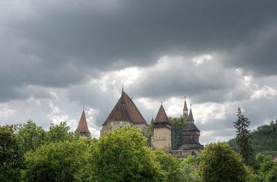 Shot of Calnic Fortified Church from afar - Transylvannia, Romania