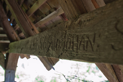 Writings on the wooden structure at the bell tower - Transylvannia, Romania