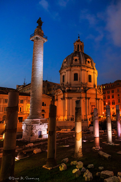 Trajan's Column, Santissimo Nome di Maria al Foro Traianoand the remains of the ruins of Basilica Ulpia (as well as Santa Maria di Loreto) as seen from Trajan's Forum at night.