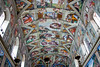 Michelangelo's Sistine Chapel Murals on the ceiling in brilliant colors