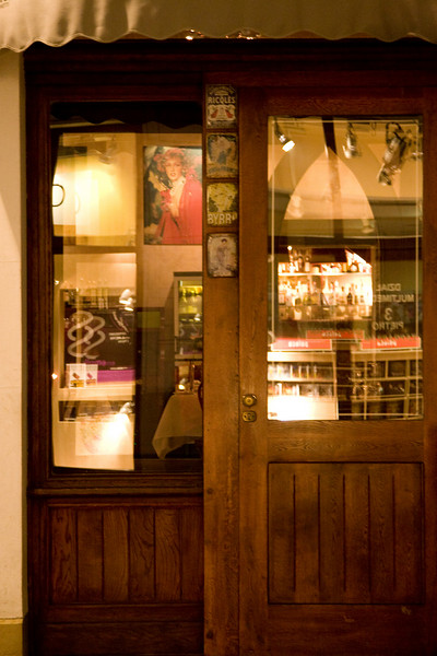 Restaurant door at night in Krakow's main square