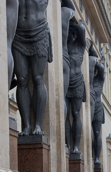 Statues of Atlas, holding up a portico at the State Hermitage Museum