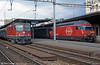 Swiss Railways 11186 on a stopping service and 460 028 at Geneva Cornavin in August 1995.