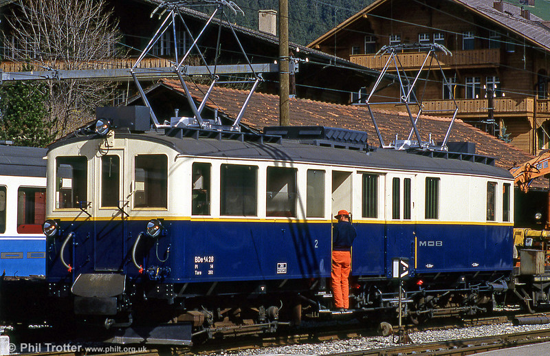 The Swiss Montreux - Oberland Bernois railway is a metre-gauge system linking Montreux with Zweisimmen. On 24th April 1992, BDe 4/4 car 28, introduced in 1924 and used for goods haulage is seen at Zweissimen.