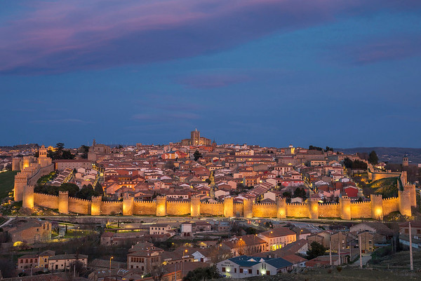 the town of Avila at dusk with castle walls