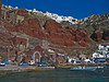 View of Oia from Ammoudi Harbor below with spectacular colors