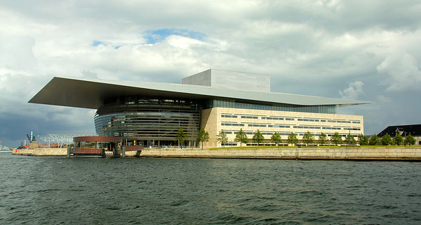 The Copenhagen Opera House (opened 2004) It is located just opposite the main castle Amalienborg at the shore of the harbor. The opera house is built in alignment with Amalienborg and The Marble Church, so that if one stands in the main entrance of the Opera, one can see the Marble Church over the water along the road through Amalienborg. ---Copenhagen, Denmark