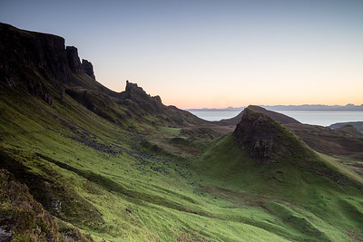The Quiraing Isle of Skye with sweeping views of green covered hills at sunrise
