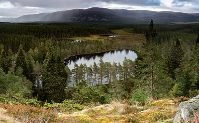 An overview of Uath Lochan with approaching rain in the Cairngorms
