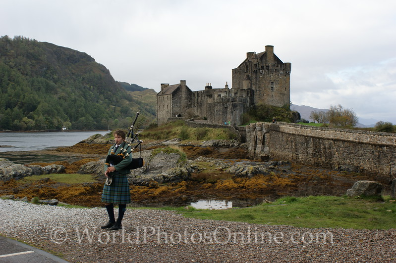 Loch Duich - Eilean Donan Castle with Piper.JPG