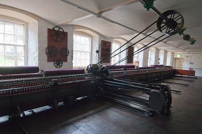 Milling equipment inside Robert Owen Mill Museum in New Lanark, Scotland