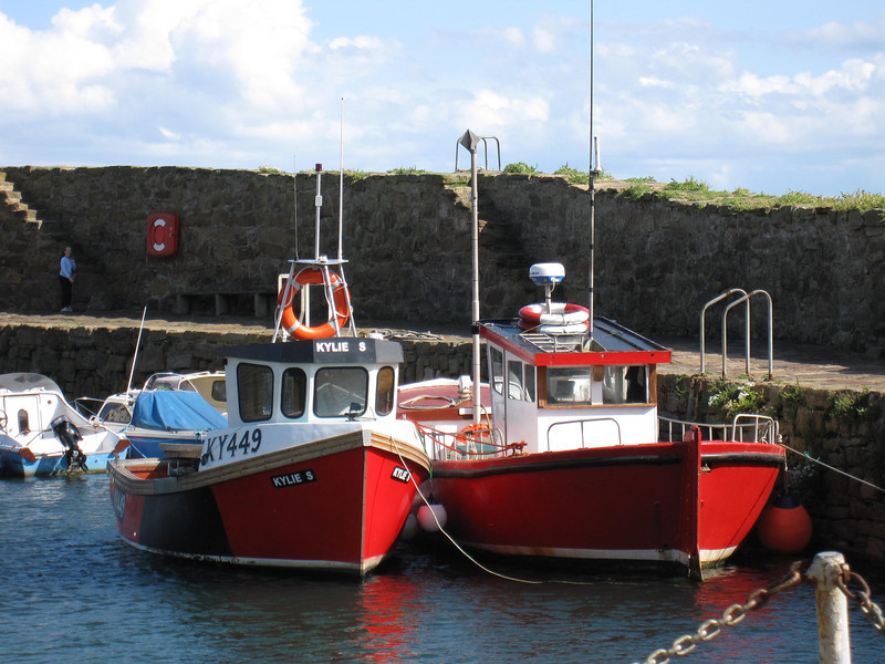 colorful boats crail harbor scotland