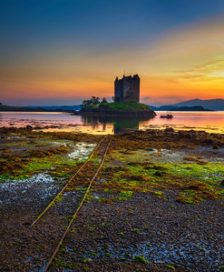 Sunset over Castle Stalker on Loch Appin in Scotland, United Kingdom