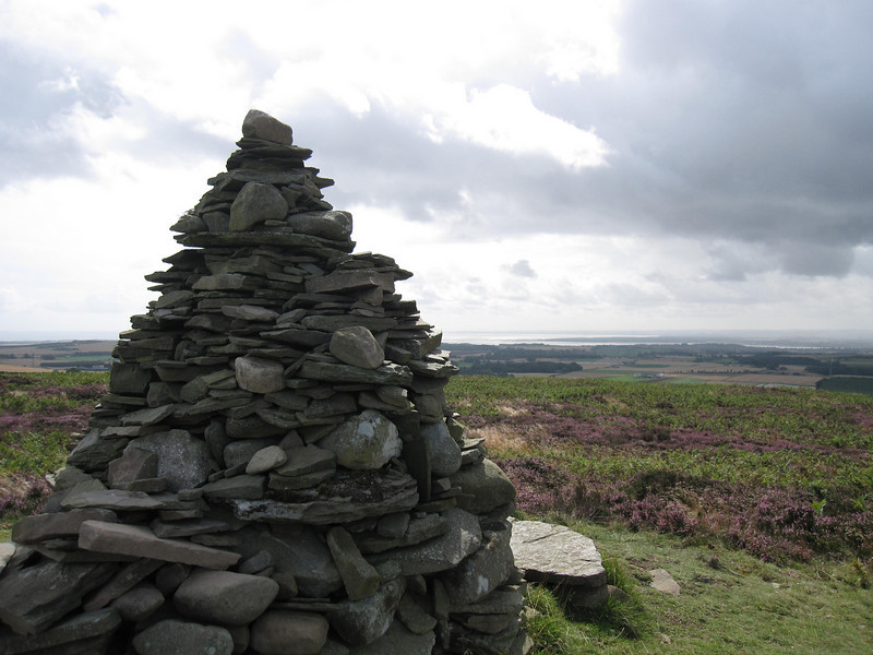 Piled Rocks and North Sea in far Distance