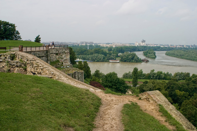 High above the Sava and Danube confluence, on the rocky ridge which opens the view of Novi Beograd, Zemun and wide plains of Pannonia, there is the Belgrade Fortress with Kalemegdan, the former historical and urban center of Belgrade. This spatial complex consists of: The Fortress, divided into Upper Town and Lower Town, and the Kalemegdan park, the most popular promenade for Belgrade citizens.