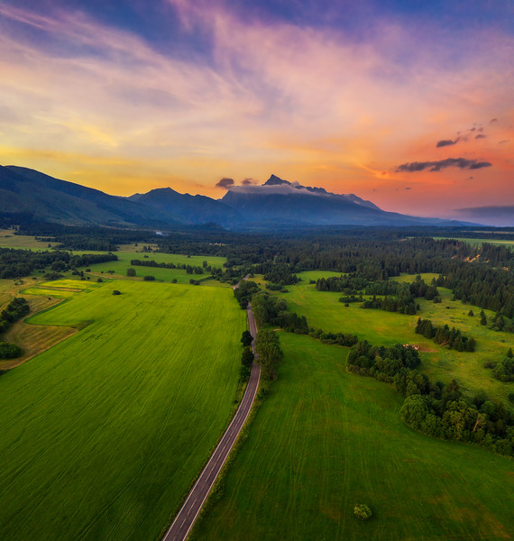 Country road to the High Tatra Mountains at sunset in Slovakia