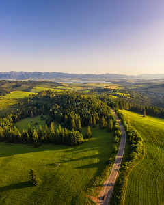 Road going through forests and villages of the Liptov region in Slovakia