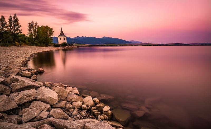 Sunset over a little church in Liptov, Slovakia