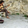 a great Classical guitarist and his dog to entertain tourists